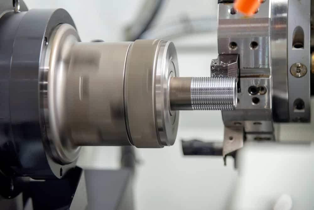 Acme thread being manufactured with a machine.