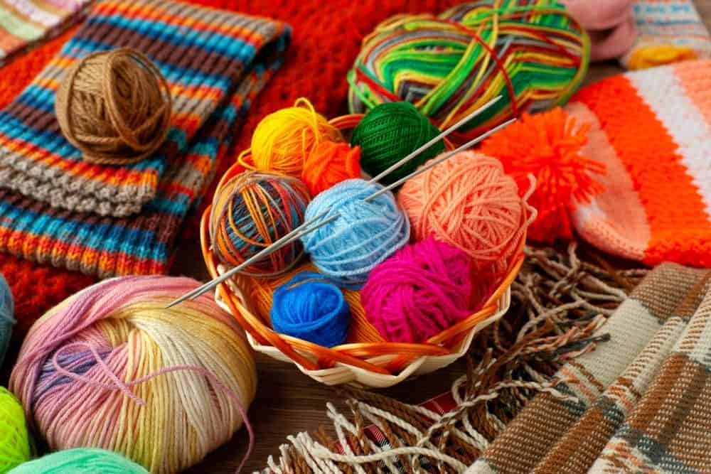 This is a close look at various spools of yarn as well as knitted products.