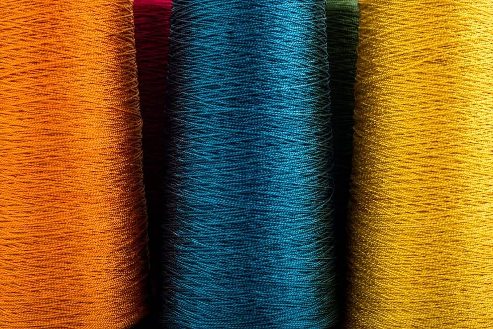 A close look at spools of rayon yarn.
