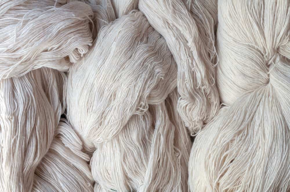 A close look at clumps of white cotton yarn.