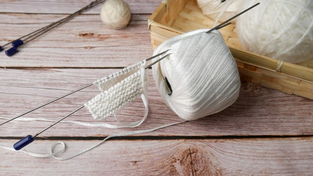 A ball of white bamboo yarn.