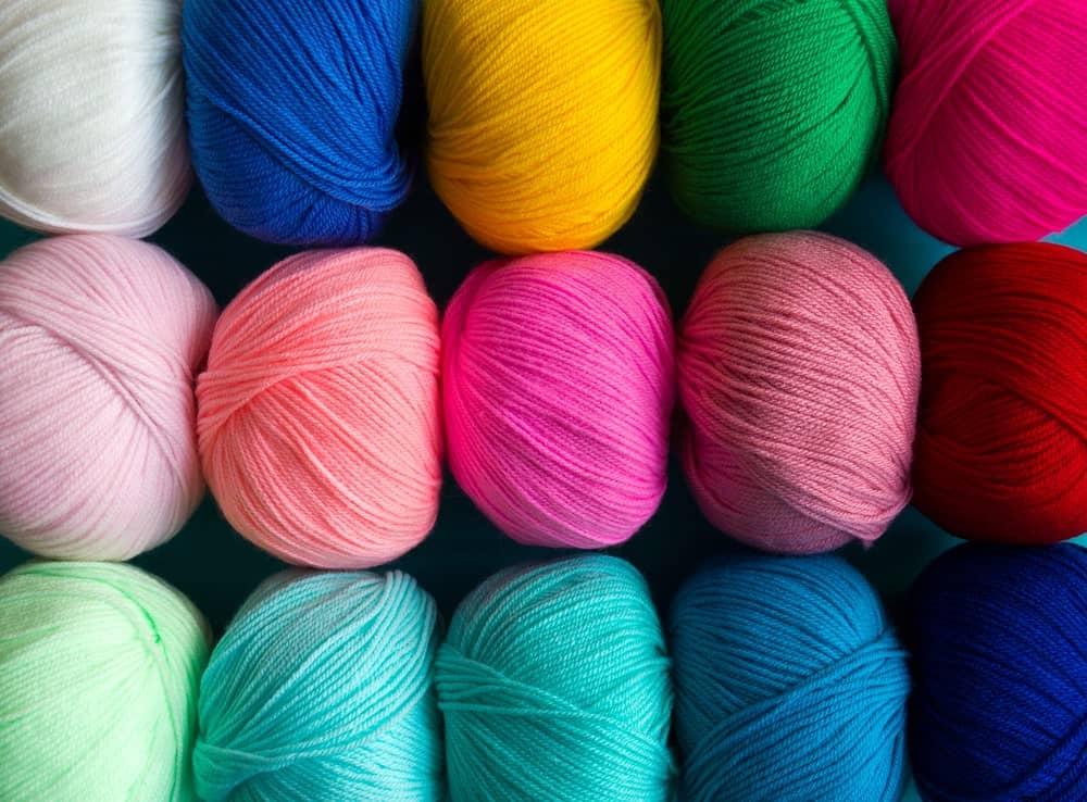 Balls of colorful acrylic yarn.