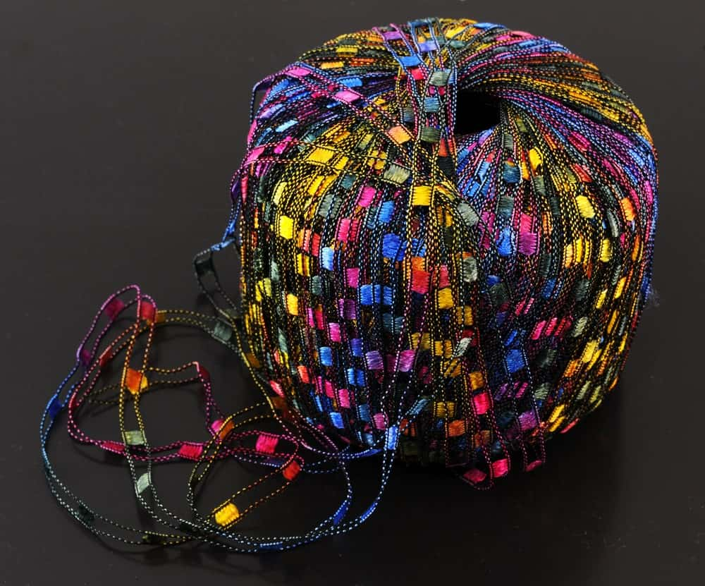 A ball of railroad ribbon yarn for knitting.