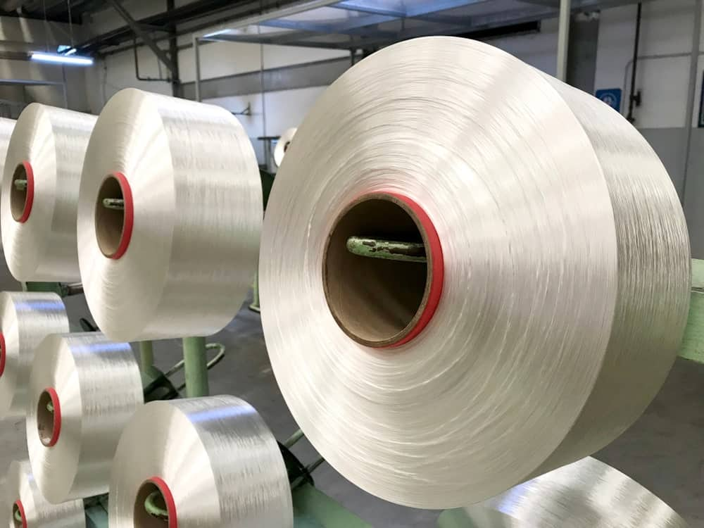 Large rolls of polyester yarn.