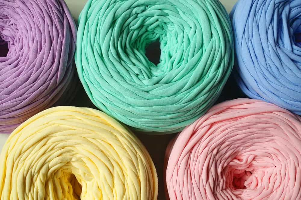 Rolls of colorful ribbon yarn.
