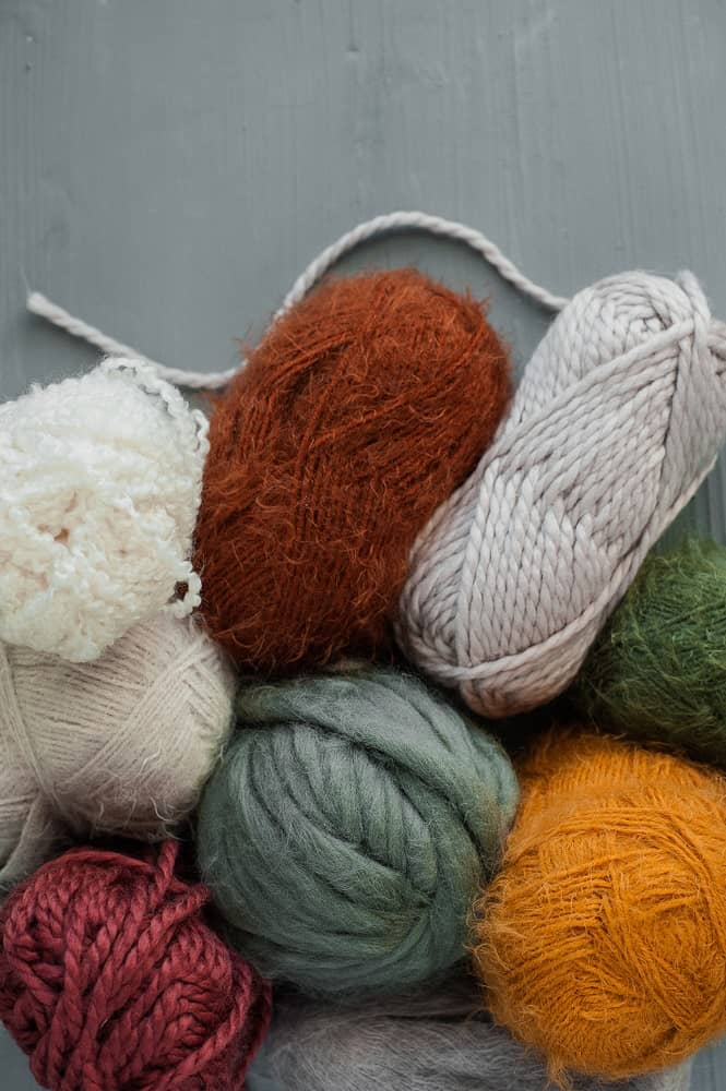 Balls of wool blend yarns in different colors.