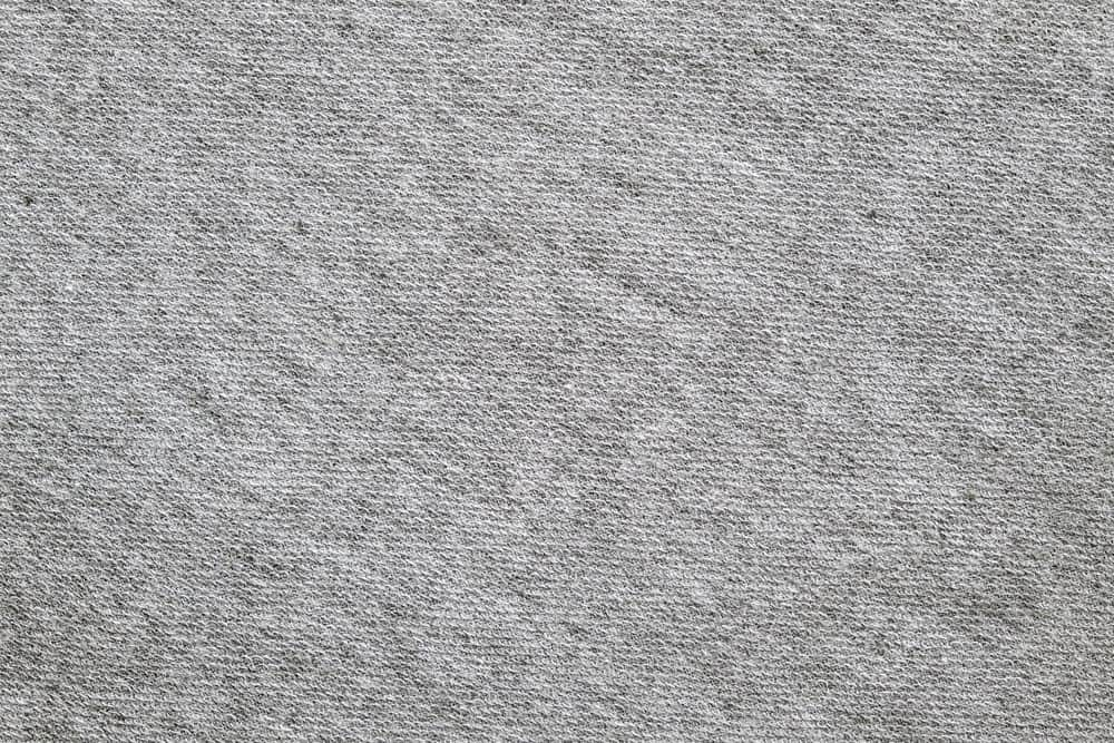 A close look at a gray polyester blend twill pattern.
