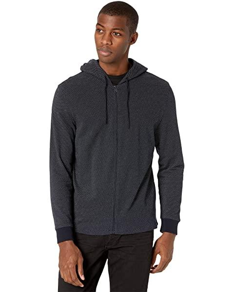Man wearing a zip-up hoodie.