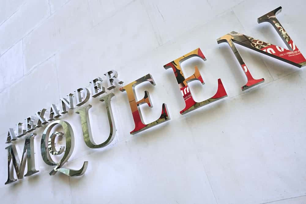 Alexander McQueen logo on fashion store.
