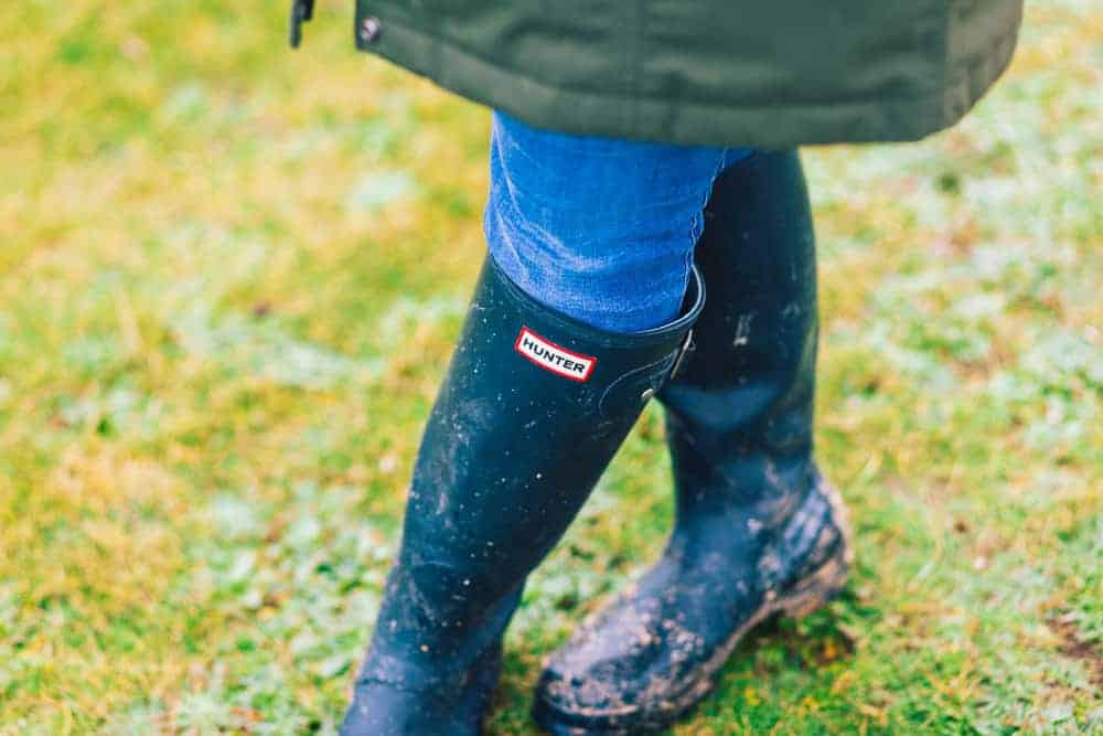 Woman wearing hunter boots with antibacterial lining.