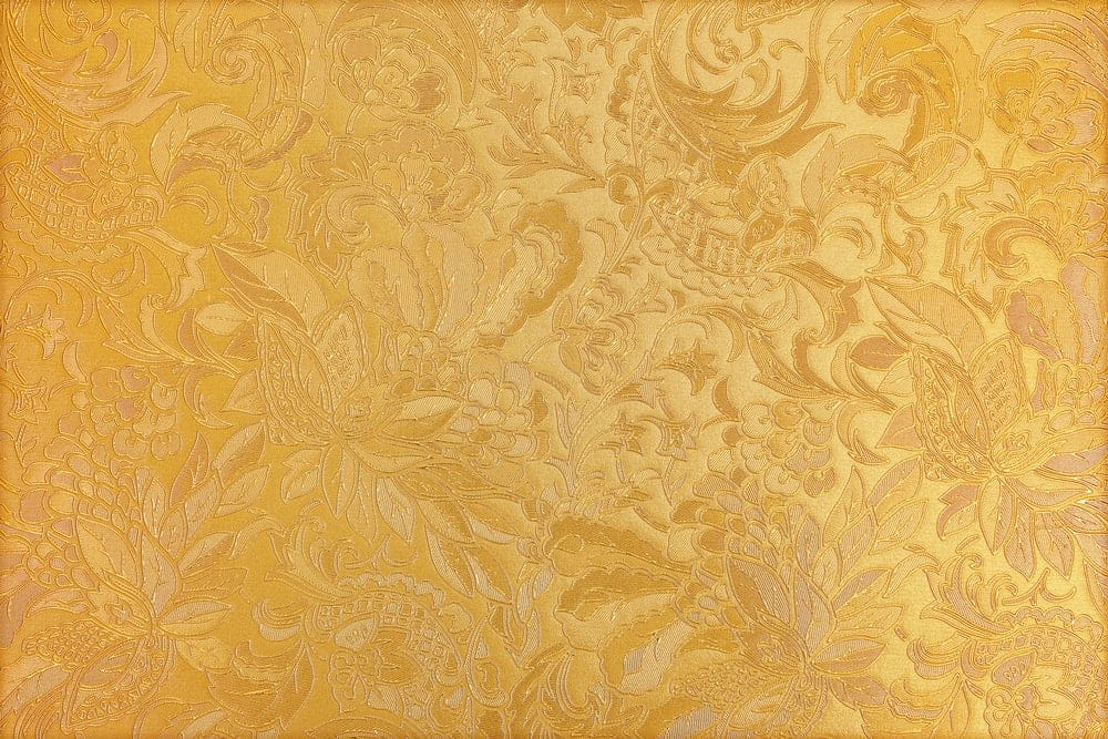 Gold textile with brocade texture