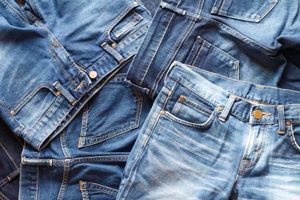A pile of denim pants.