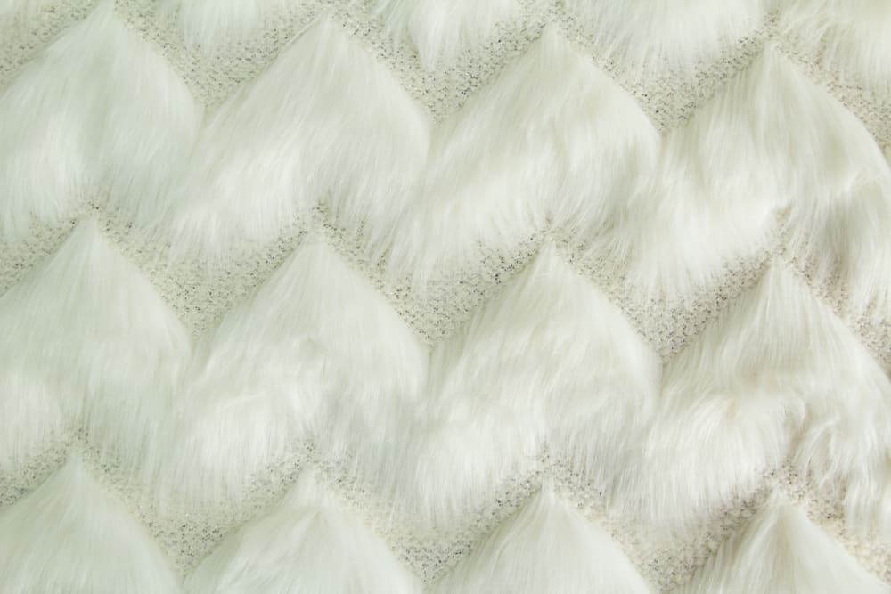 Textured faux fur fabric with long pile.