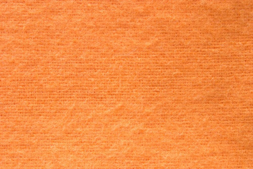 Orange fabric with flannel texture.
