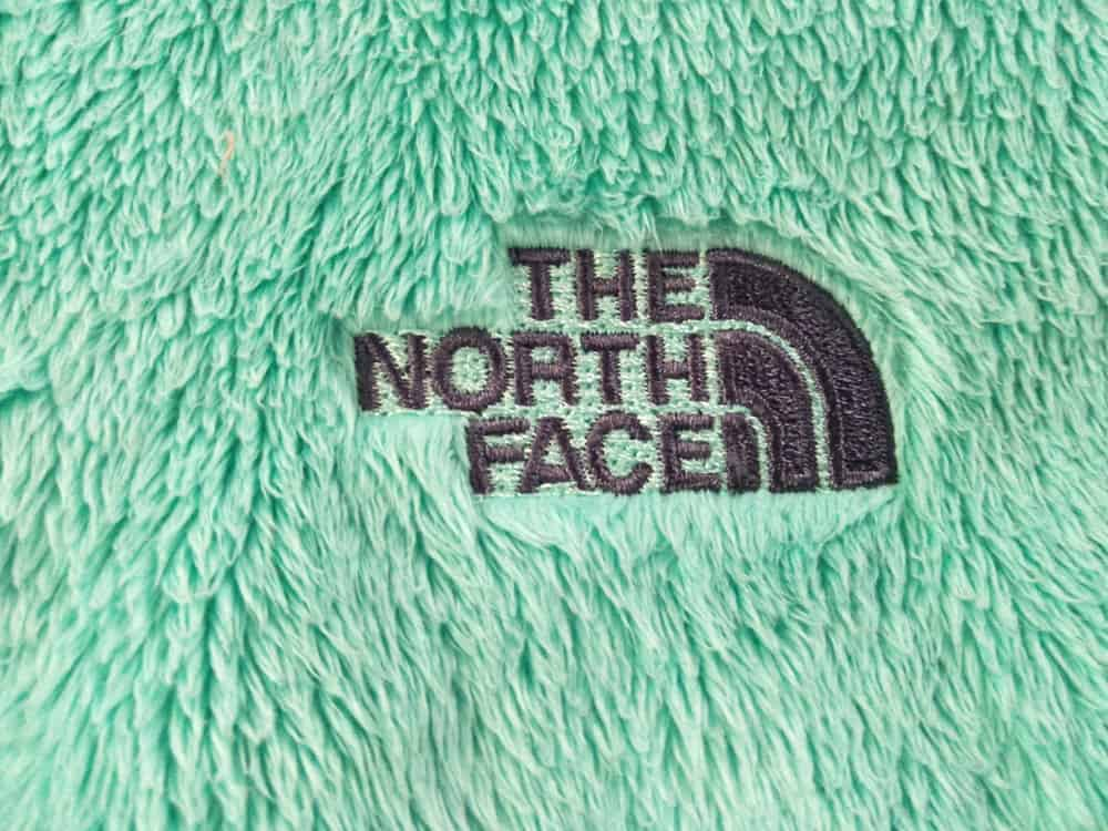 Fleece jacket with The North Face logo.