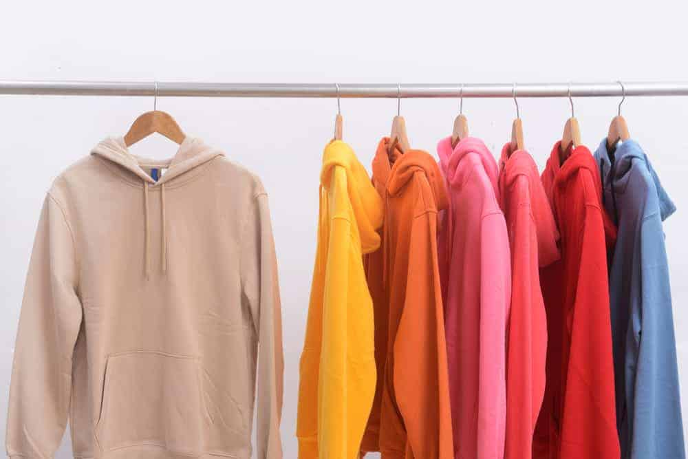 This is a close look at a rack of hoodies in different colors.