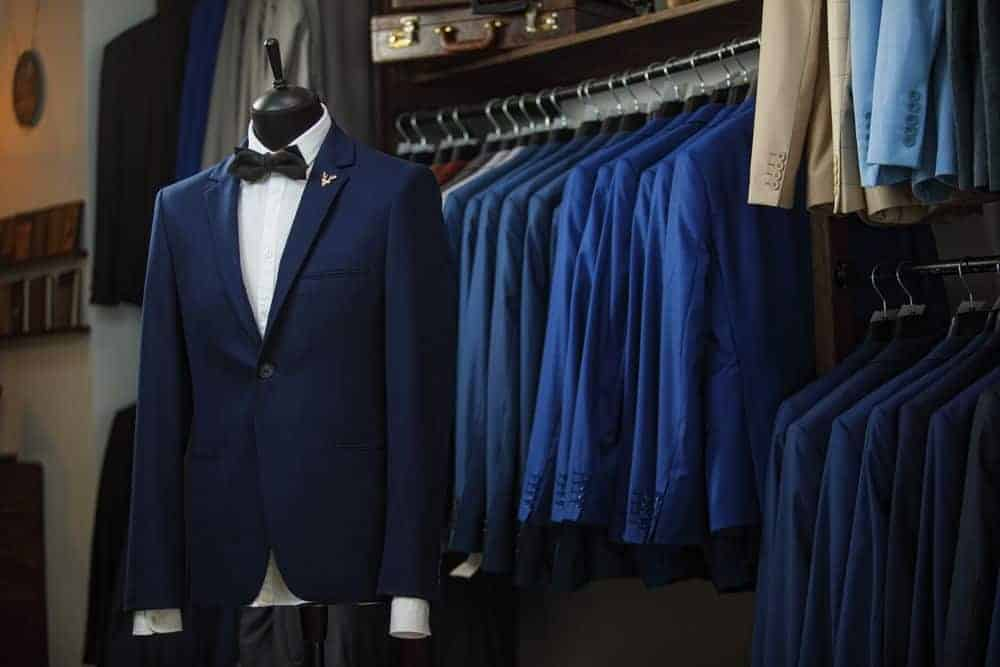 Display of men's suits in a boutique.