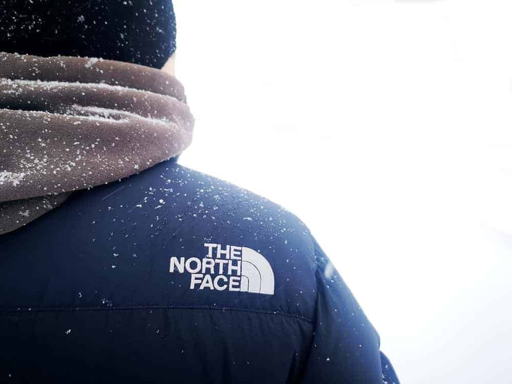Back profile of a man wearing The North Face jacket.