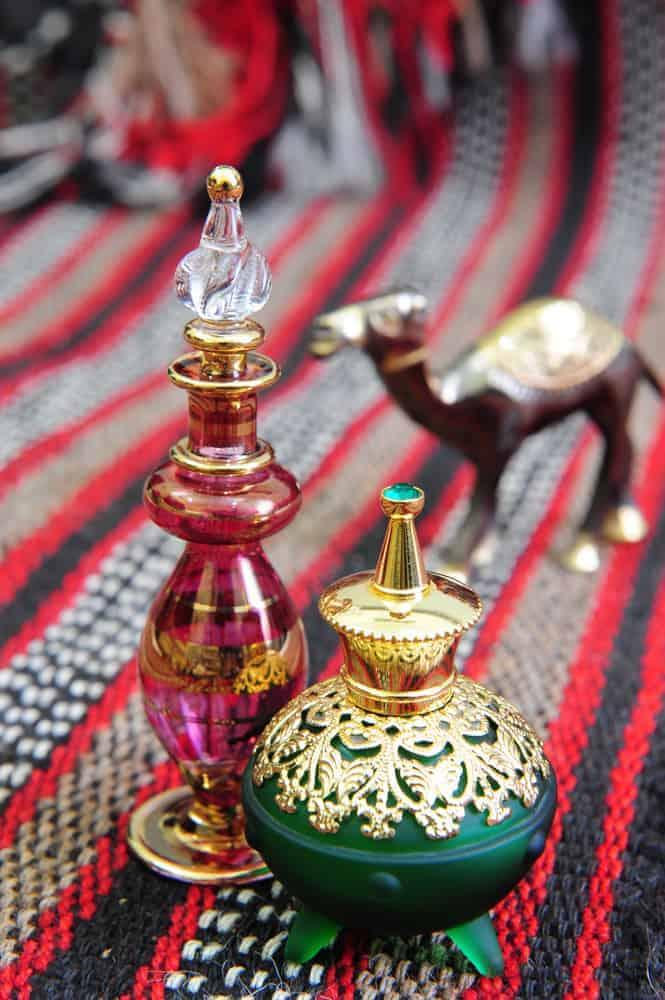 Egyptian perfume bottles on a hand-woven Omani rug.