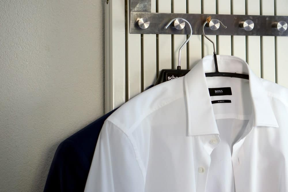 This is a close look at a couple of Hugo Boss shirts in hangers.