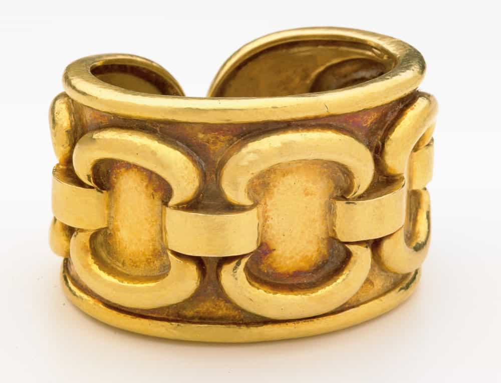 This is a close look at a golden cuff bracelet.