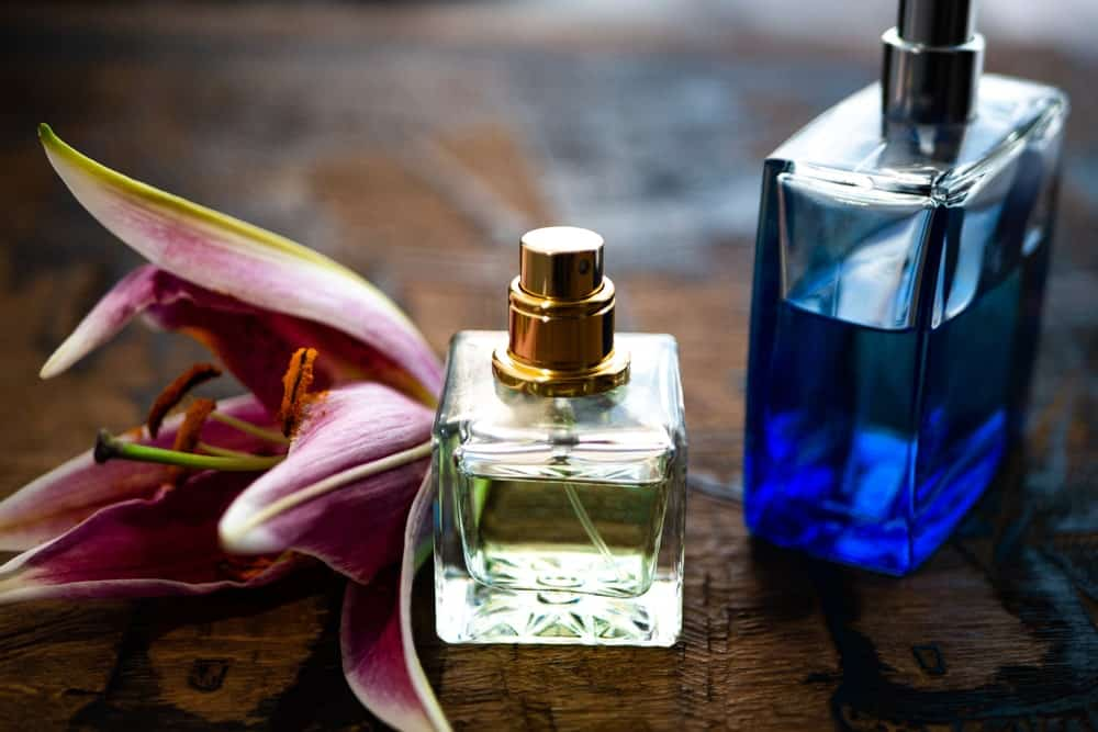 This is a couple of perfume bottles with a Lilly flower.