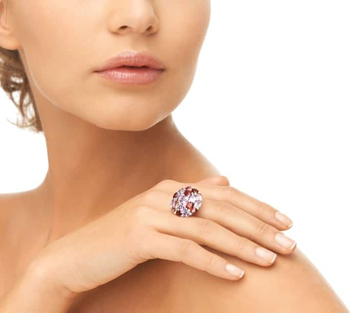 This is a close look at a woman wearing a cocktail ring.