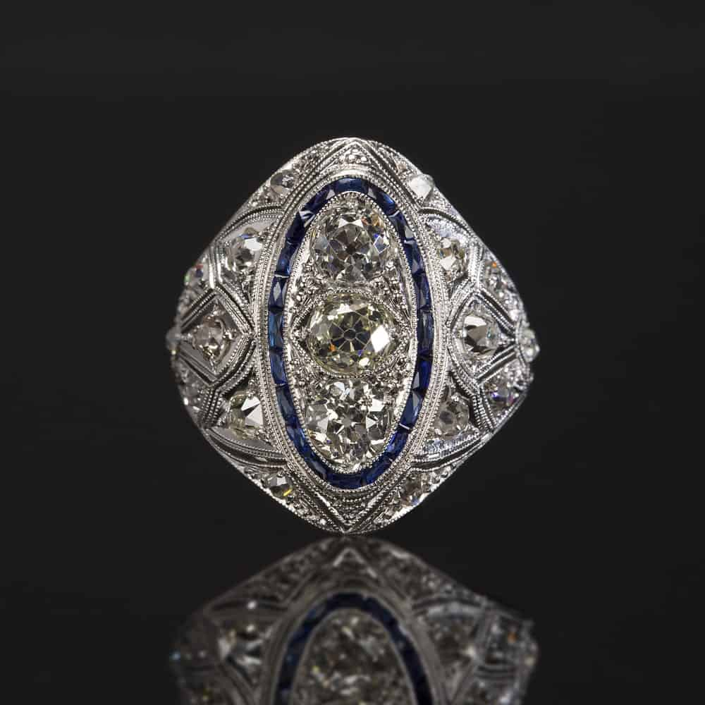 This is a close look at an estate ring against a dark surface.