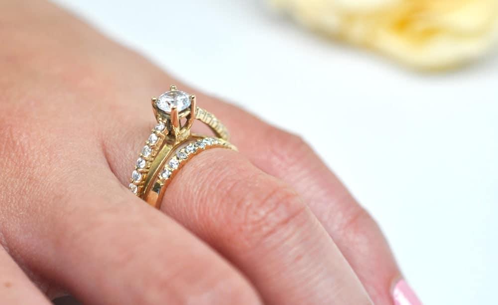 A close look at a bridal set ring that has gold bands and diamonds.