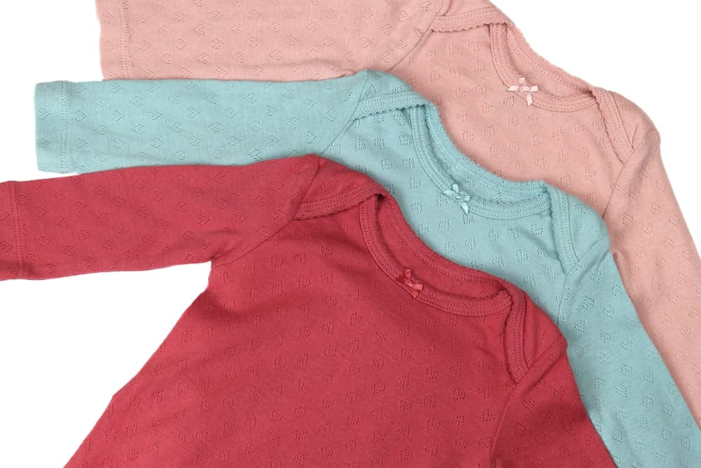 A close look at three pairs of colorful on-piece shirts with sleeves.