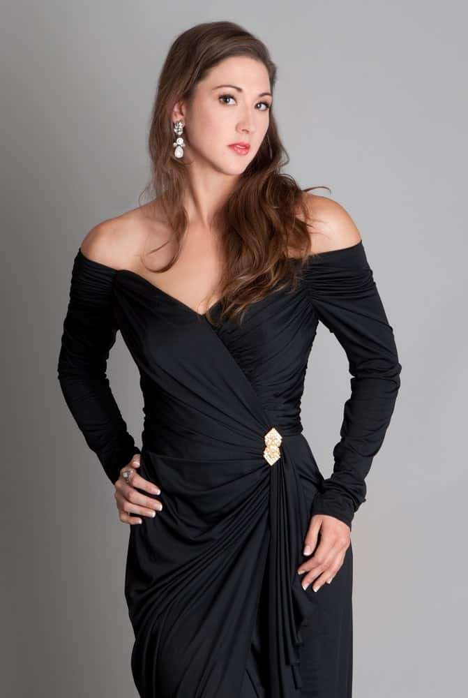 This is a close look at a woman wearing an elegant off shoulder dress.