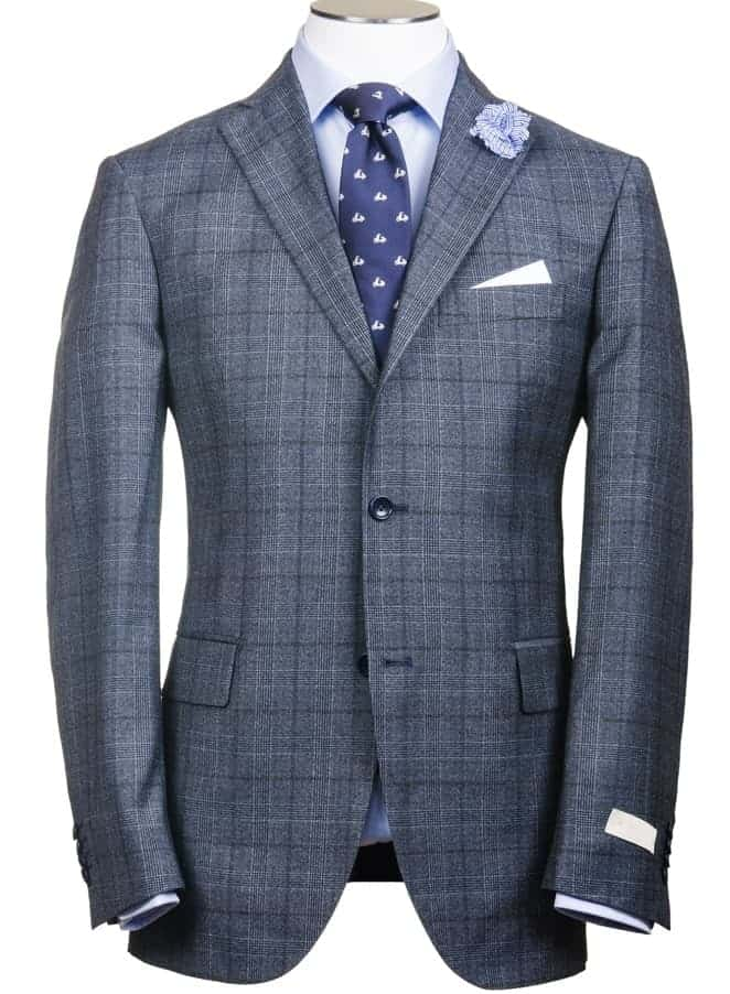 This is a close look at a patterned suit with tailored sleeves.