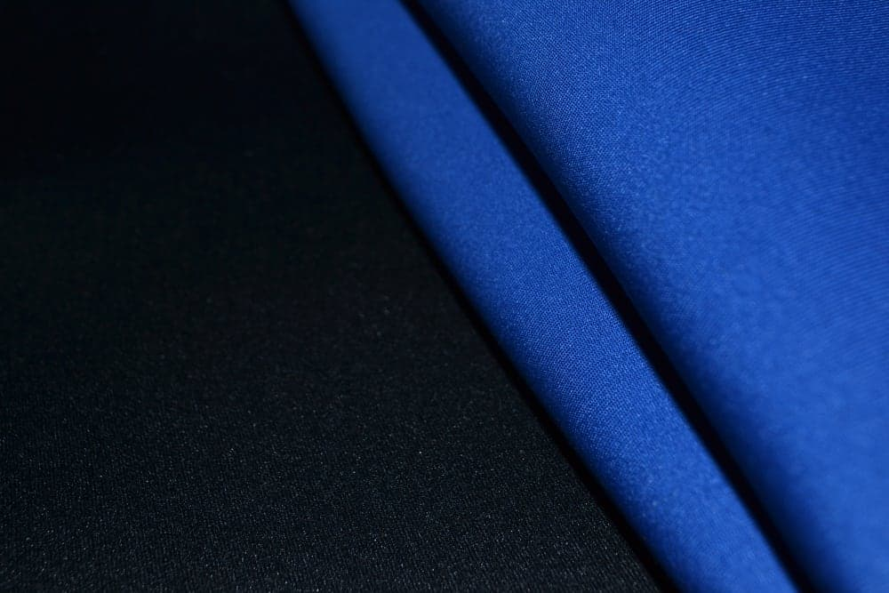 This is a close look at blue and black Neoprene Rubber fabrics.