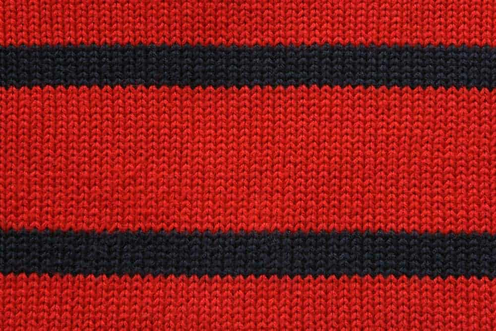 This is a close look at a red and black knitted fabric.