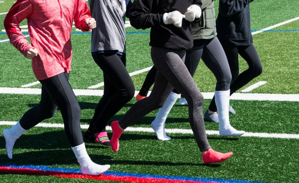 A close look at a group of women wearing spandex leggings.