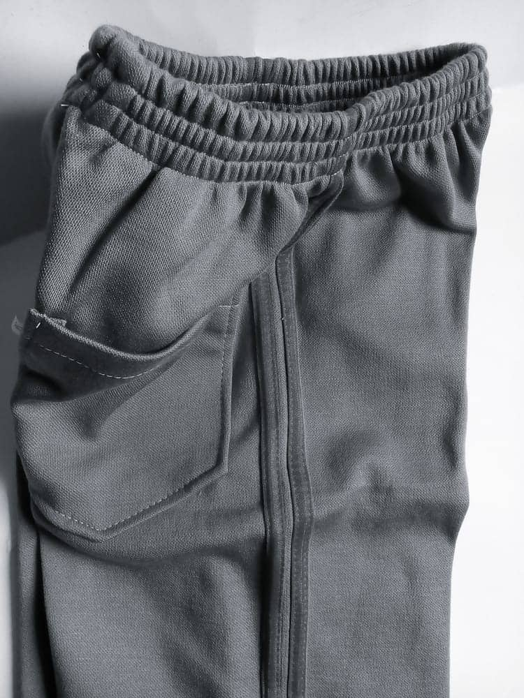 A close look at a pair of gray stretch denim pants.
