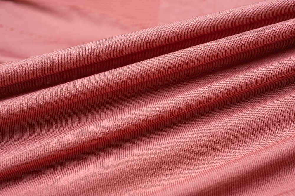 This is a close look at a piece of pink Knit Fabric.