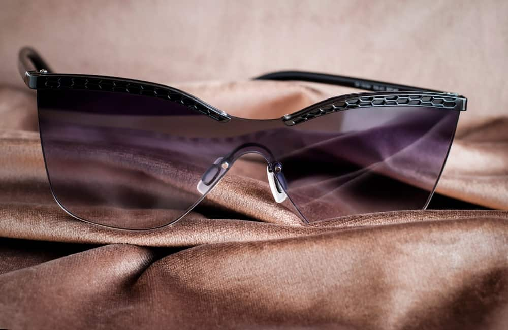 A pair of fashionable sunglasses with gradient lenses.