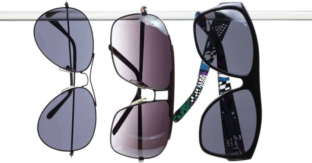 Three pairs of sunglasses with glass lenses.