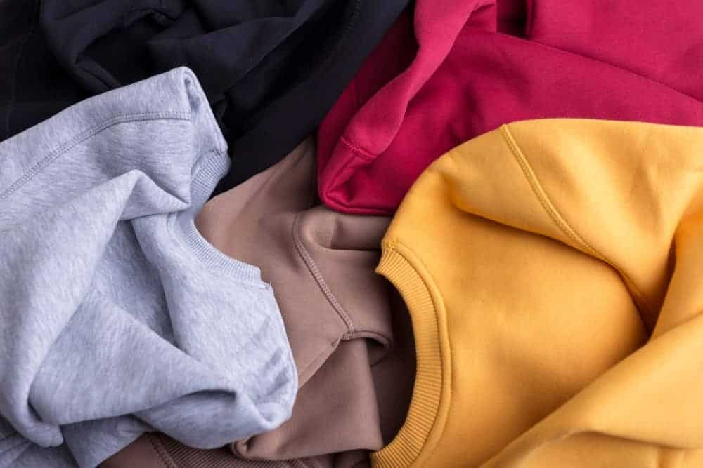 This is a close look at a bunch of various sweatshirts.