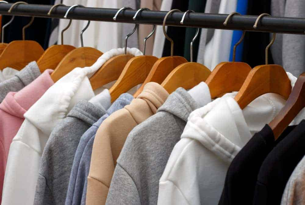 This is a close look at a rack of sweatshirts.
