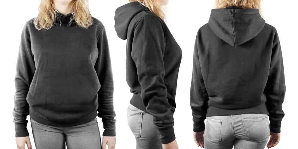 Front, back and side view of a black pullover sweatshirt worn by a woman.