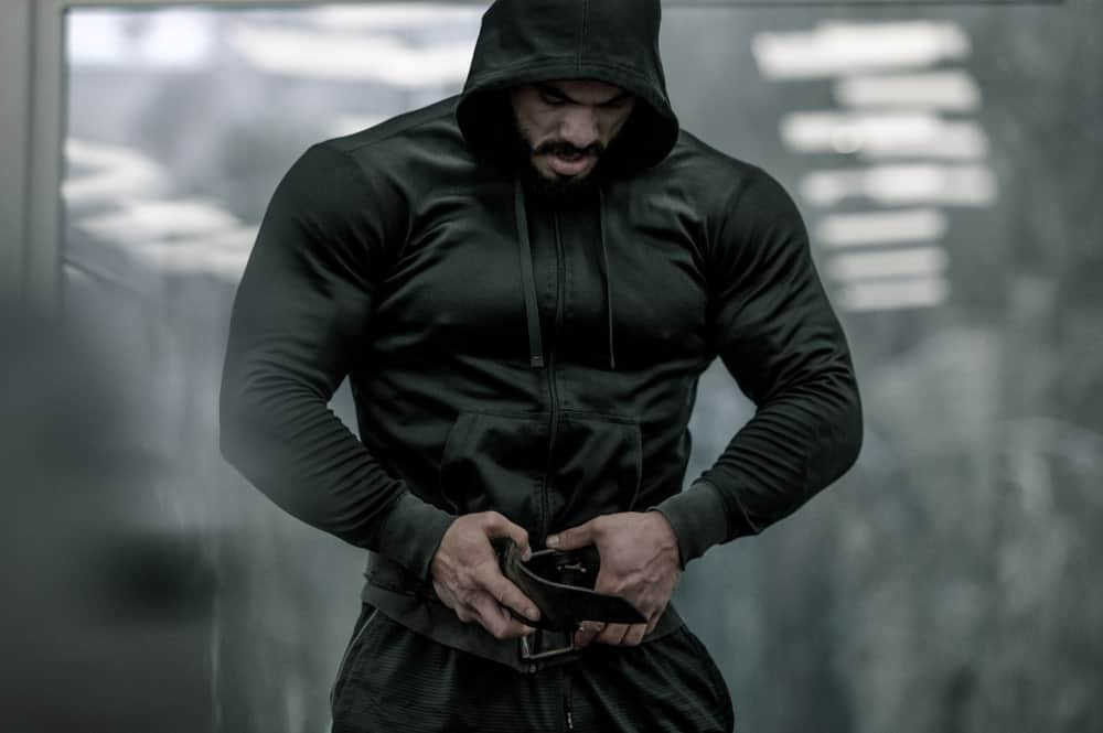 This is a look at man wearing an athletic sweatshirt with a hood.