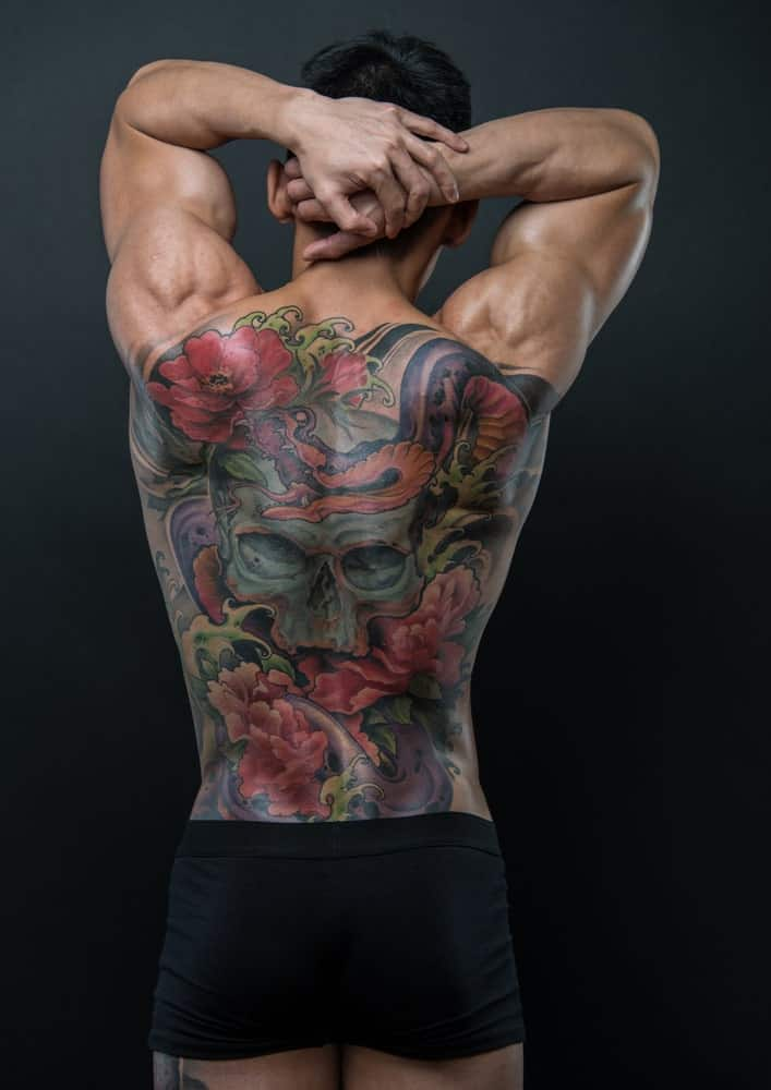 This is a close look at a man's back with Japanese tattoos.