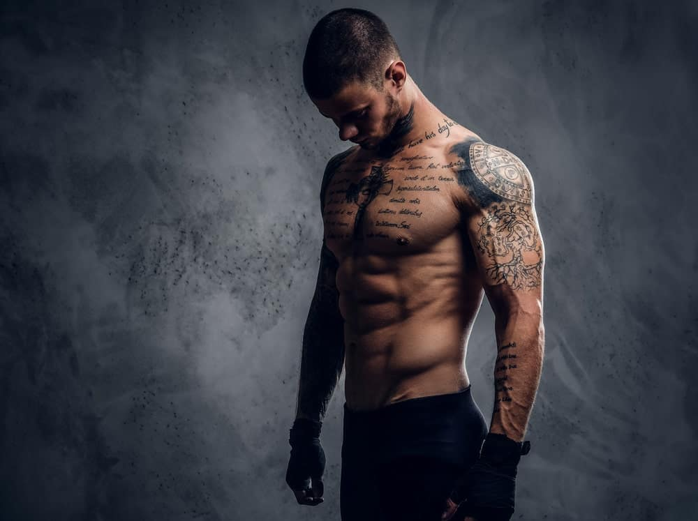 A man with multiple tattoos on his chest and arms.