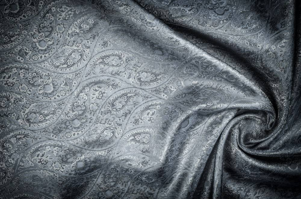 This is a piece of patterned cloth that has Jacquard weave.