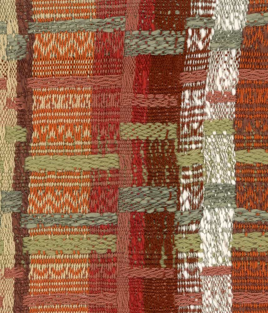 A close look at a colorful patterned cloth that has dobby weave.