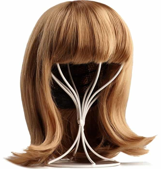 A blonde wig with bangs on a wig stand.