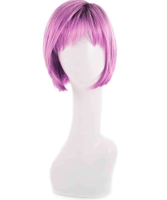 A close look at a purple wig on a white wig storage.