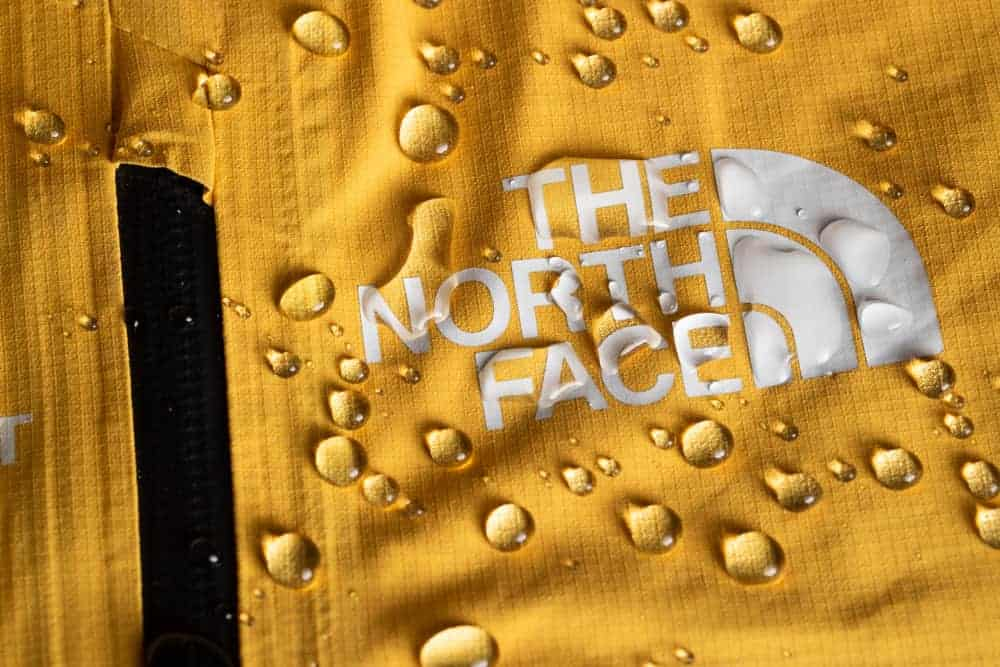 Waterproof The North Face jacket in yellow.